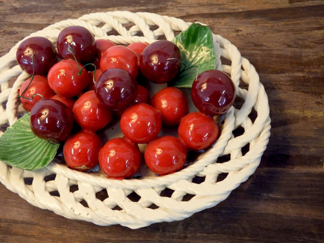 Ceramic braided bowl and cherries