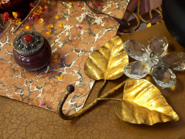 Faceted crystal and brass flower, marbleized paper and small decorative pot