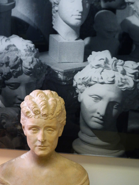 sculpted bust with photo of busts