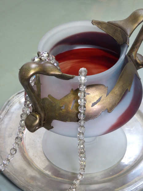 white frosted glass cup with red and gold accents and crystal beads