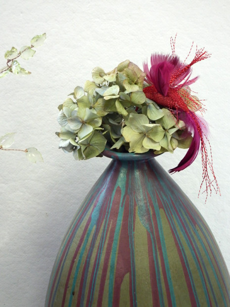 Large multicolored striped vase with dried hydrangeas